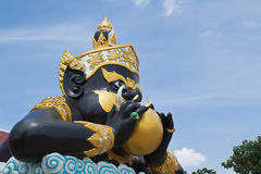 Statue of black deity called Rahu Stock Photography