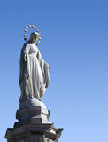 Statue of Blessed Virgin Mary. In Lviv over blue sky Royalty Free Stock Photos