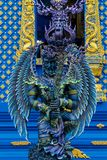Statue of angel guard in Blue temple Chiang Rai, Thailand. Statue of blue angel guard portrait in Wat Rong Suea Ten Blue temple in Chiang Rai Thailand stock photo