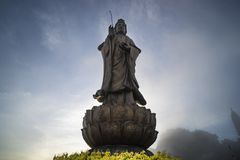 Statue of the Bodhisattva on Fansipan mountain peak the highest mountain in Indochina Backdrop Beautiful view blue sky and cloud. Statue of Bodhisattva on stock photos