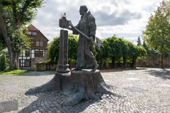 The statue of Boniface near the cathedral of the small German to royalty free stock image