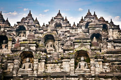 A statue of the Borobudur temple on Java , Indonesia. stock image