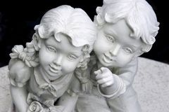 Statue of boy and girl. Statue of boy pointing upwards for girl Stock Photos