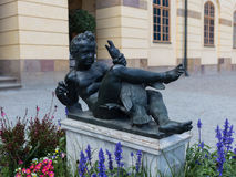 Statue of a boy with a goose in the territory of the Royal Palace Drottningholm Stock Image
