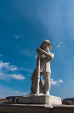 Statue of a boyagainst blue sky. Belvedere garden Wien. Royalty Free Stock Photo