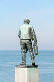 Statue of the brave rescuer, Netherlands. Rear view of the statue of the brave rescuer in front of the North Sea, in Visslingen, Zeeland province, southwestern Royalty Free Stock Photos