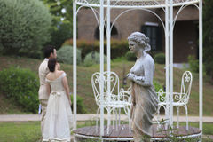 Statue with  Bride and Groom are in the garden. Royalty Free Stock Photo