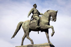 Statue of the bronze horseback rider. Against the sky Royalty Free Stock Images