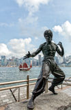 A statue of Bruce Lee in a 'ready to strike' pose. The statue wa. Hong Kong, China - July 15, 2015: a statue of the martial arts expert and film star Bruce Lee ( Stock Images