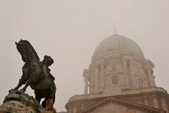 Statue at the Budapest castle. And fog Stock Photos