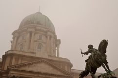 Statue at the Budapest castle. And fog Royalty Free Stock Photography