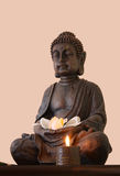 Statue of Buddha. Statue of Gautama Buddha with a candle and a flower Royalty Free Stock Image