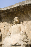 Statue of buddha. Maximal buddha statue in Longmen Grottoes. The Longmen Grottoes with Buddha's figures are located on both banks of the Yi River, near Luoyang Stock Image