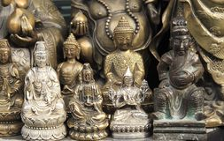 Statue of Buddha. These are metallic statues of Buddha.People believe Buddha can bring to them lucky and richly Stock Image