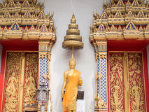 Statue of Buddha in Abhaya Mudra posture with tiered umbrella Stock Image