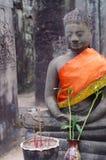 Statue of buddha among Angkor ruins stock photo