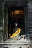 Statue of Buddha at Angkor Wat. Statue of Buddha  in an old temple in Angkor Wat, Cambodia Stock Image