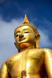 Statue buddha on blue sky background Royalty Free Stock Images