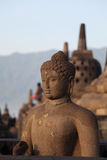 Statue of Buddha in Borobudur temple Stock Photo