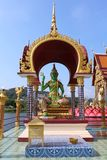 Green buddha statue in thailand stock photos