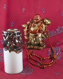 Statue of Buddha, candle, beads made of wood Stock Photography