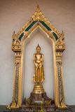 Statue of Buddha on Chapel of Wat Phra Si Mahathat Stock Image