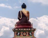 Statue of buddha among clouds stock photo