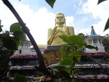 Statue of buddha dambulla in Sri Lanka stock photo
