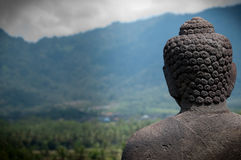 Statue Buddha Facing the Mountains Stock Photography