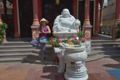 Temple at the Can tho -  Vietnam. Statue of Buddha in front of the temple in Can-tho Vietnam Stock Image