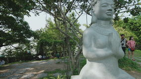 Statue of a Buddha in the garden stock video