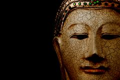 Statue of Buddha head with black space in background royalty free stock photography