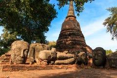 Statue Buddha Head Remain and Pagoda of King Borommarachathirat II of the Ayutthaya Kingdom called Ratburana Temple Stock Image