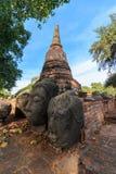 Statue Buddha Head Remain and Pagoda of King Borommarachathirat II of the Ayutthaya Kingdom called Ratburana Temple. (locally know as Wat Ratburana Stock Photo