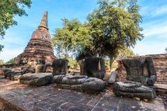 Statue Buddha Head Remain and Pagoda of King Borommarachathirat II of the Ayutthaya Kingdom called Ratburana Temple. (locally know as Wat Ratburana Royalty Free Stock Photos