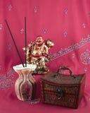 Statue of Buddha, jewelry box, incense Stock Photo