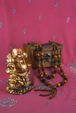 Statue of Buddha, jewelry box, wooden beads Royalty Free Stock Images
