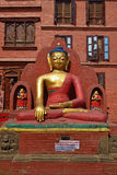The statue of Buddha is located at the Swayambhunath Temple in N Stock Image