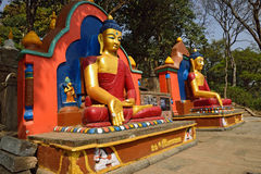 The statue of Buddha is located at the Swayambhunath Temple Royalty Free Stock Photography