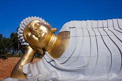 Statue of Buddha lying down. Resting Royalty Free Stock Image