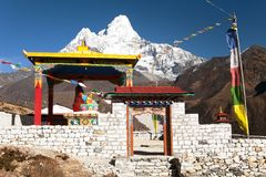 Statue of buddha in Pangboche monastery, mount Ama Dablam. New statue of buddha in Pangboche monastery and mount Ama Dablam, Khumbu valley near Tengboche, way to Royalty Free Stock Photos