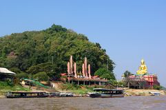 Statue of Buddha on river Mekong Royalty Free Stock Photos