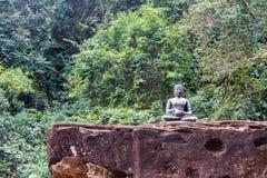 Statue of Buddha on the rock in Kood island Royalty Free Stock Photo