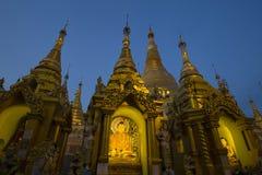 Statue of Buddha at Shwedagon Pagoda in Yangon, Myanmar, Burma. Night view. Statue of Buddha at Shwedagon Pagoda in Yangon, Burma, Myanmar. Shwedagon Pagoda is Royalty Free Stock Photography