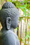 Statue of buddha in zen garden. Close-up of statue of buddha in zen garden with bamboo Royalty Free Stock Images