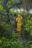 A statue of a Buddhist monk at the main temple of Thailand. Royalty Free Stock Photo