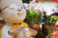 Statue of Buddhist novice Stock Image