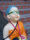The statue of Buddhist novice Stock Images