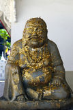 Statue of Budha. Covered with tin leaves of gold. Worshipers buy small particles of gold an put it on the sculpture during religous ceremony Stock Image