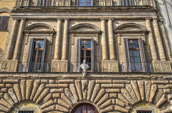 Statue in a building facade. In Florence, Italy royalty free stock photo